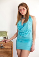 Keira Blue strips naked in high heels and glasses for Femjoy - 1 of 12